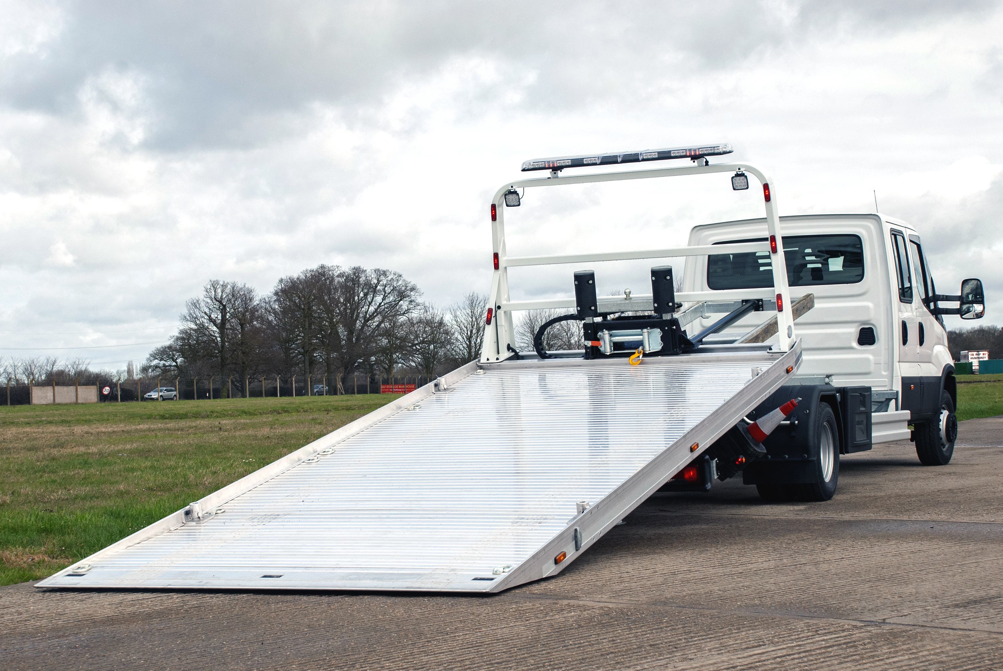 New stock Iveco Daily 70C18 slide bed tilted back